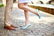 Leinwanddruck Bild - Male and female legs during a date