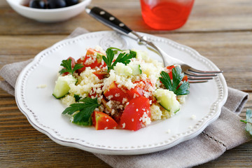 Salad with arabic couscous and vegetables on a plate
