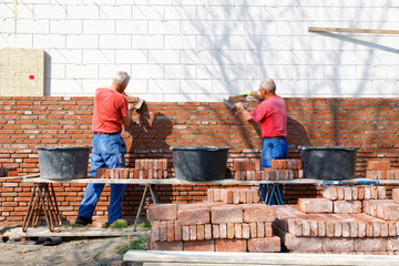 bricklayers are building as a team