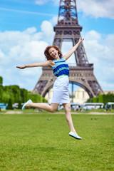 Girl jumping near the Eiffel Tower in Paris