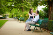 Dating couple on a bench in a Parisian park