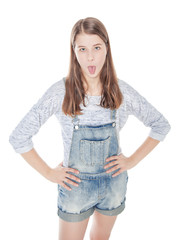 Young fashion girl showing tongue isolated. Top view