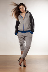 front view of young woman in track suits and high heels
