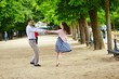 Couple dancing in the Luxembourg garden of Paris