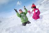 Kids having fun playing in the snow