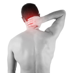 Rear view of a young man holding his back in pain