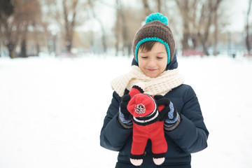 boy playing with a toy in the park in the winter