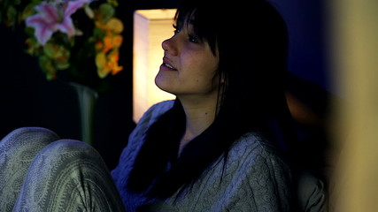 Beautiful sad woman starting to cry in bed closeup