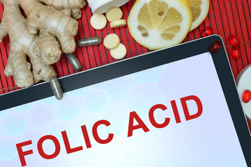 Tablet with words Folic acid. Healthy eating.