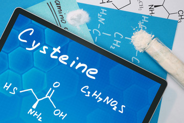 Tablet with the chemical formula of  Cysteine. Amino acids.