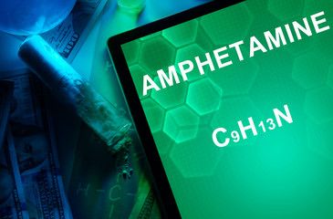 Tablet with the chemical formula of Amphetamine.