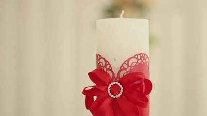 White candle on a white background