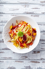Tagliatelle with peppers, red onion and basil