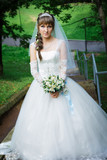 Bride standing on a staircase - 77897573