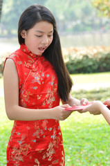Asia female teenager surprise and glad when receive red envelops
