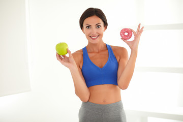 Smiling sporty lady on a diet deciding