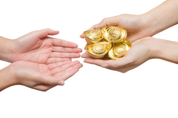 Hand giving chinese gold ingots
