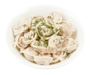 Dumplings and parsley - russian pelmeni - italian ravioli