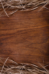 Empty wooden rustic board with straw, free copy space for text