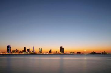 Beautiful illuminated buildings and Bahrain skyline