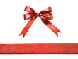 Red fabric ribbon and bow isolated on a white background - 77901378