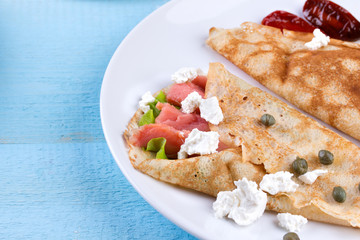 Thin pancakes, crepes with salmon