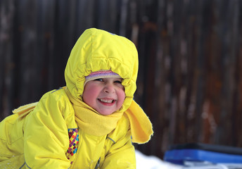 laughing little girl in winter