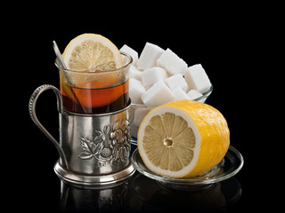 Tea with the big lemon and is a lot of lump sugar