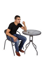 young man drinking coffee at a table