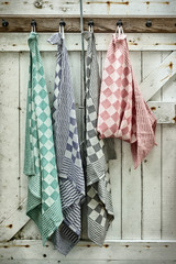 Retro styled image of hanging dish cloths