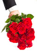 man's hand with red roses bouquet