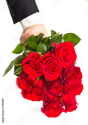 canvas print picture man's hand with red roses bouquet