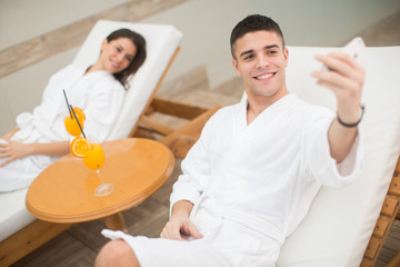 Young couple relaxing by the pool