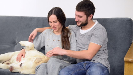 Couple spending time together with labrador