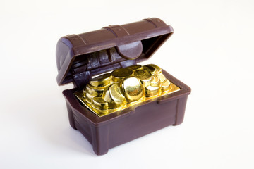 Toy chest full of gold coins