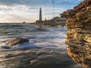 lighthouse and yellow stone