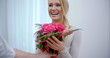 Pretty Girl Surprised with Bouquet of Flowers