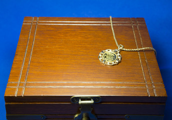 Pendant that was made using gold coin on wooden present box