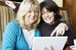 Two mature woman digital tablet