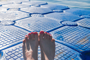 feet on the pontoon on a hot summer day, Egypt,Red sea.