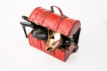 women shoes are in wooden chest