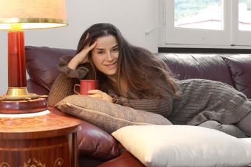 relaxed girl over sofa with tea mug