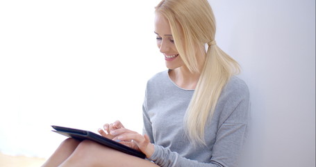 Happy Young Woman Busy with Tablet Computer