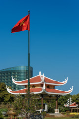 Viernam - the flag, the pagoda and the modern building