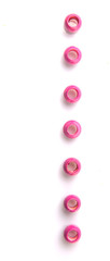 Pink round wooden beads over white background