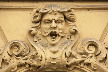 Funny mascaron on the Art Nouveau building