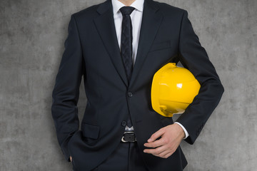 engineer holding helmet