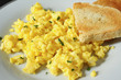 Scrambled eggs with toasted bread - 77914374