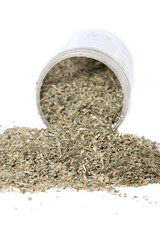 Dried green catnip  spilling from container