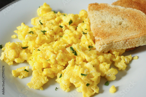 Foto op Canvas Egg Scrambled eggs with toasted bread